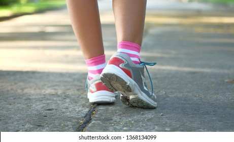 Close up of female jogging shoe in a park.