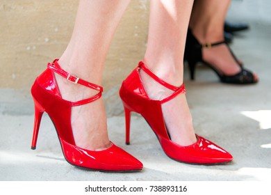 Close up of female legs with red heels