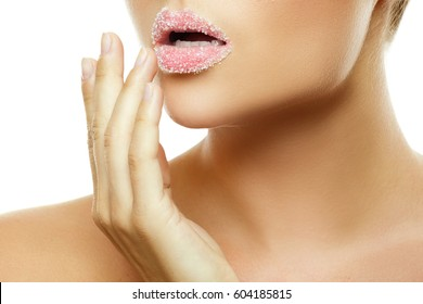 Close up of female lips with sugar