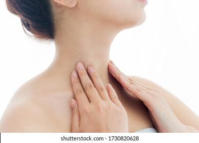 Close up of female neck on white background.