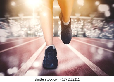 Close up of female runner foots running on the track with fast motion blur background while doing competition in the stadium