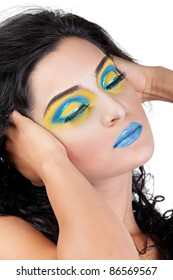 Close up of a Female's Face Wearing Blue and Yellow Makeup