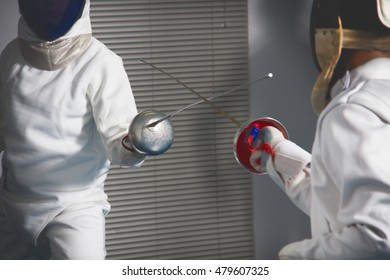 a close up of fencers  back and cut face In action