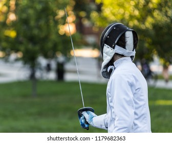 Close up of a fencing athlete in attacking position