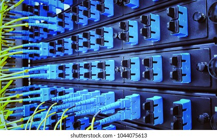 Close up fiber optic in server room , network cables installed in the rack