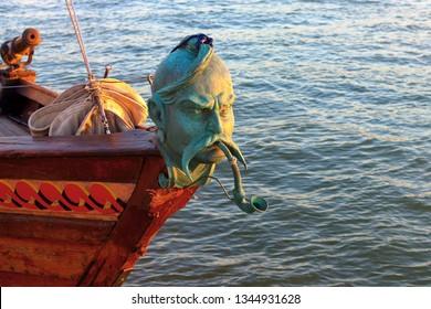 Close up of figurehead of a vintage sailing ship. Kozak head