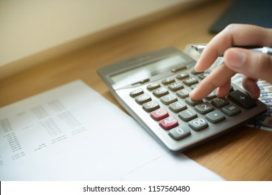 close up of financial inspector calculating fee, tax, valuation in an office