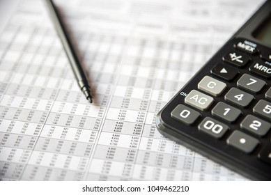 Close up of financial number on a spreadsheet in columns and rows, checking balance, preparation of a balance sheet. Calculating number for income tax return.