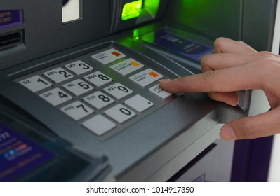 Close up of finger press buttom enter on keyboard of ATM machine