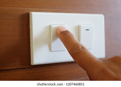 Close up finger is turn on or turn off on switch