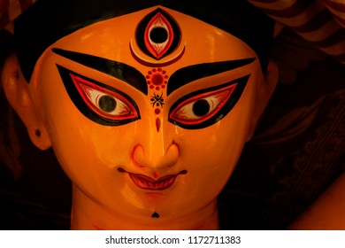 A close up finished face of a clay idol of Goddess Devi Durga,  before upcoming Durga Puja, at KUMARTULI, KOLKATA, WEST BENGAL, INDIA