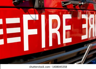 Close up of FIRE sign on the front of a British fire engine.