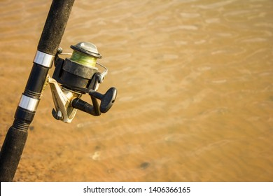 close up to a fishhook beside the lake