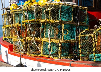 Close up of fishing boat filled with colourful fishing baskets in Cape Town, South Africa