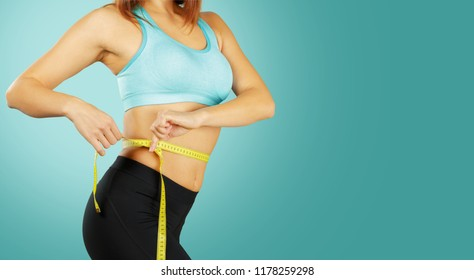 Close up of fit woman's torso. Female with perfect abdomen muscles