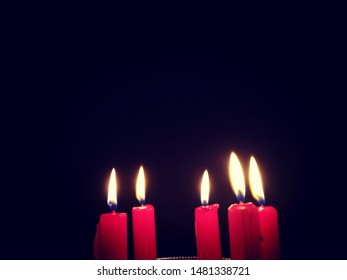 Close Up of Five Christmas Candles on Dark Background