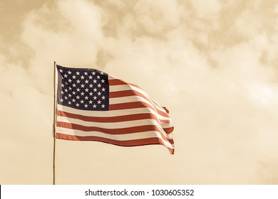 Close up Flag of United States of America (USA) waving in the wind agent smoke