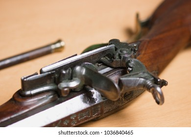 Close up of flintlock mechanism on old military firearm