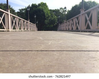 Close up floor of wooden white bridge in the park.