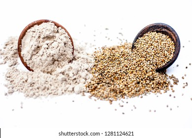 Close up of flour of pearl millet or bajra in a clay bowl with raw pearl millet in a clay bowl isolated on white.