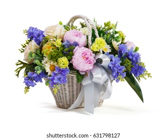 Close up flower bouquet arrangement in wicker basket isolated on white, carnation, rose, orchid, anunculus