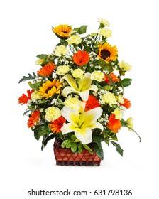 Close up flower bouquet arrangement in wicker basket isolated on white, lily, carnation, sunflower, gerbera, chrysanthemum