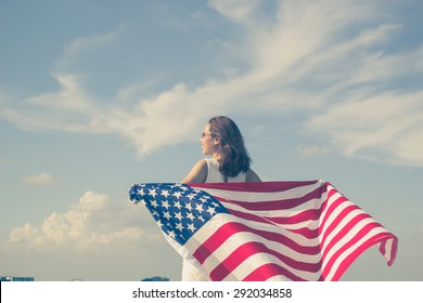 close up focus on asian woman stand facing the sky her hands holding america usa flag for freedom and memorial concept