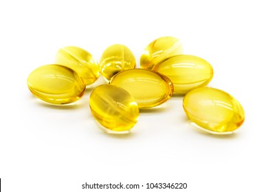 Close up of food supplement oil filled capsules suitable for: fish oil, omega 3, omega 6, omega 9, evening primrose, borage oil, flax seeds oil, vitamin A, vitamin D, vitamin D3, vitamin E