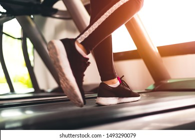 Close up foot  Fitness women running on track treadmill, exercise fitness.
