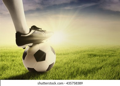 Close up of foot of football player on the ball and ready to start a game at the field