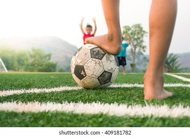 Close up of foot of poor child put on A ball be fore Conner kick in soccer game.