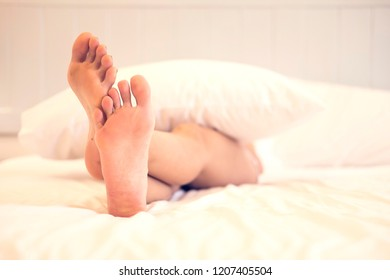 close up foot woman on bed relax concept