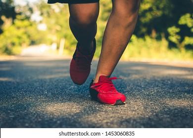 Close up foot women run feet on road in workout wellness.