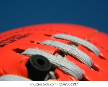 Close up of a football on a blue sky background