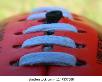 Close up of a football on a grass background