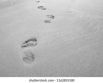 close up footprint on sand at the beach background in black and white color