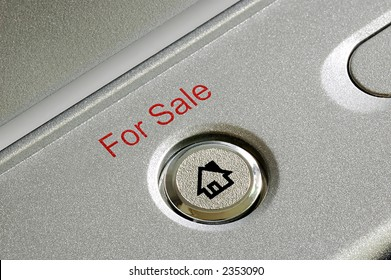 """Close up of a """"for sale"""" button"""