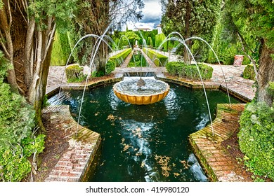 Close up of fountain in the famous avenue of cypress trees, Generalife gardens near Alhambra complex, Granada, Andalucia, Spain, one of the most beautiful in the world and is a Unesco heritage.