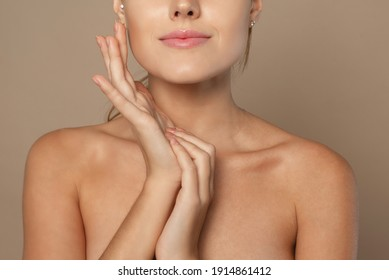 Close frame of neck and arms of a young woman. Skin care concept, skin hydration