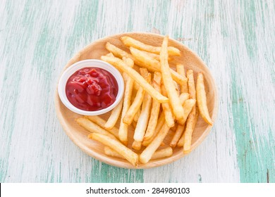 Close up french fries on a wooden background