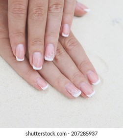 Close up french manicure on womans hands palms