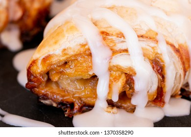 Close up of french pastry roll with icing sugar glaze.