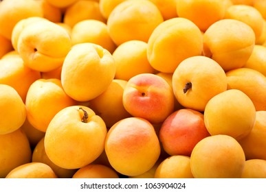 close up of fresh apricots as background