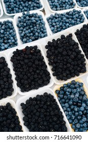 close up of fresh blueberries and blackberry on the market, fall season harvest