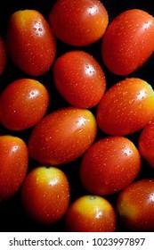 Close up of fresh cherry plum tomato