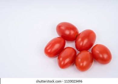 Close up of Fresh Cherry tomatoes isolated on white background with natural shadow. Top view.