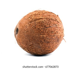 Close fresh coconut, isolated on a white background. Exotic fruit coconut. A whole and tasty brown coconut. Freshness, nature, summer concept. A tropical coconut. Healthful lifestyle.