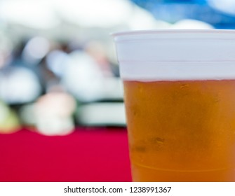 Close up of a fresh cup of beer in a plastic cup.