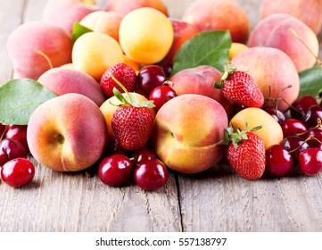close up of fresh fruits on wooden table