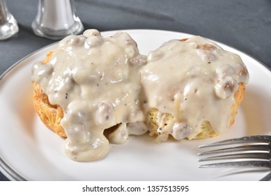 Close up of fresh homemade biscuits with country gravy and sausage bits
